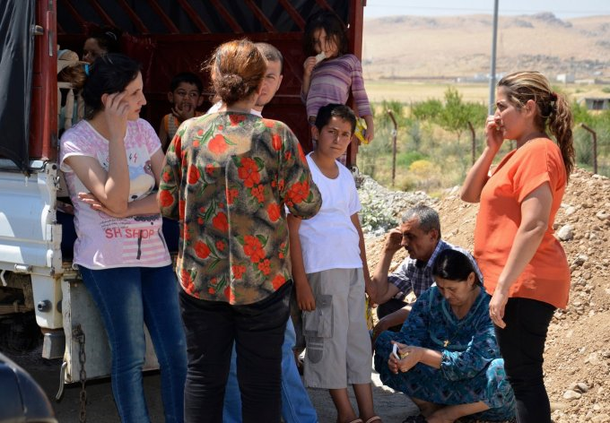 Iraqis who fled violence in Nineveh Province arrived at Sulaimaniya, in the northern Kurdish territories on Friday. [Reuters]