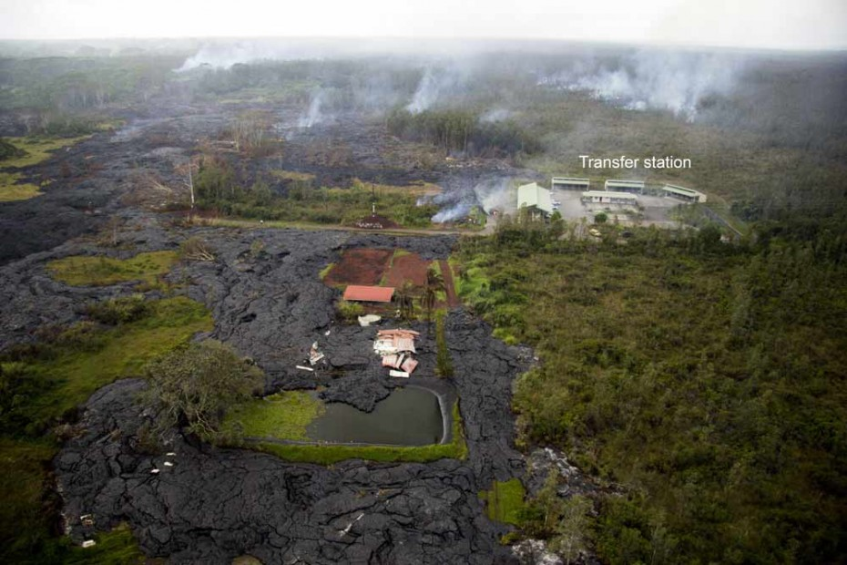 The house which was recently destroyed by lava is just below the center of the photo. Lava bypassed the garage, which still stands at the center of the photo. Lava briefly entered the fish pond next to the house, before continuing downslope.  Image: USGS