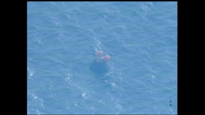 The recovery teams are within about 120 yards of the Orion crew module as it floats in the Pacific Ocean.  Photo: NASA