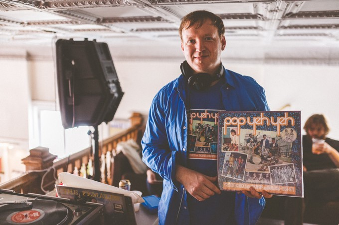 "Carl Hamm, holding the compilation of Malaysian '60s pop music he curated, ""Pop Yeh Yeh."" Photo by Samuel Dixon."