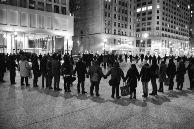 Activists link arms - March 2, 2015 [photo by Caroline Siede]
