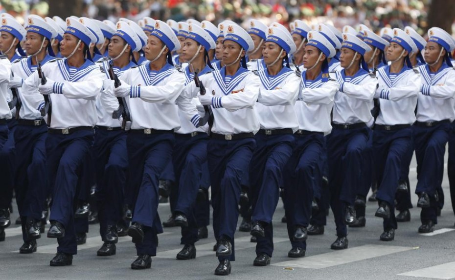 Vietnamese soldier of the Navy march during a military parade as part of the 40th anniversary of the fall of Saigon in Ho Chi Minh City, April 30, 2015.  REUTERS/Kham