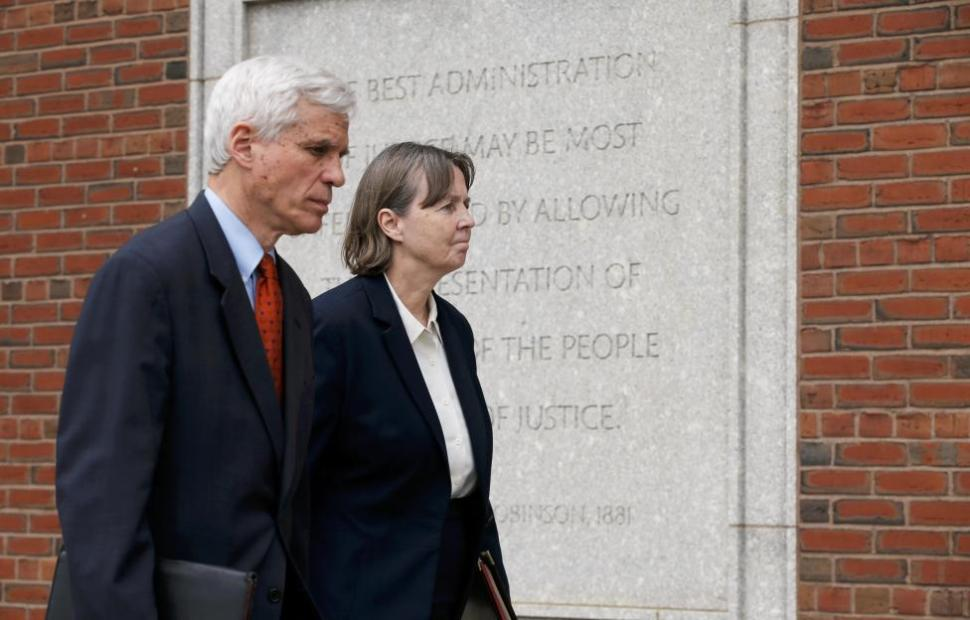 Judy Clarke (R) and David Brock, defense attorneys for Boston Marathon bomber Dzhokhar Tsarnaev, walk away from the federal courthouse in Boston, Massachusetts May 15, 2015. REUTERS/Brian Snyder