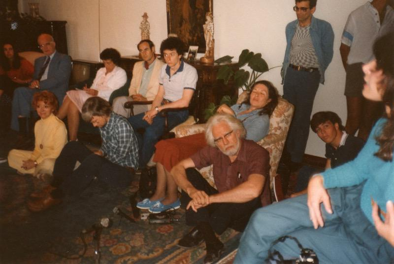 Ann and Sasha Shulgin surrounded by speakers and attendees.