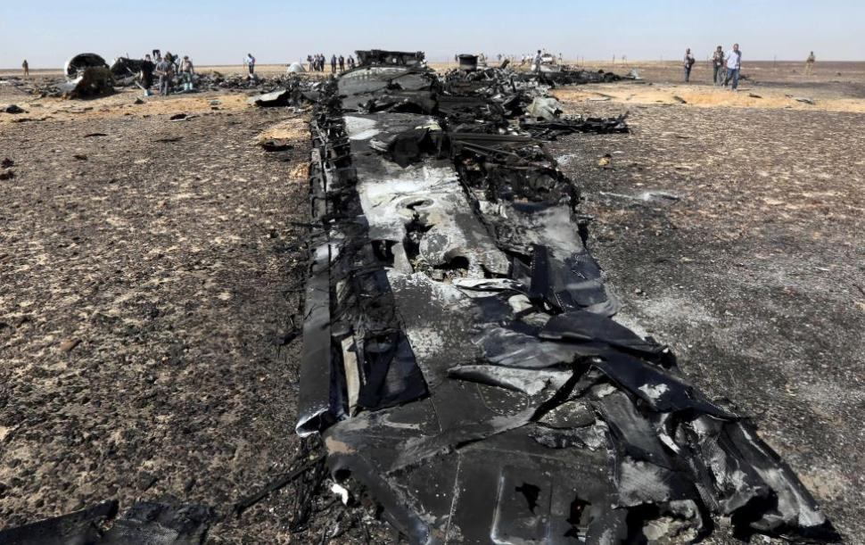 Military investigators from Egypt and Russia stand near the debris of a Russian airliner at the site of its crash at the Hassana area in Arish city, north Egypt. REUTERS