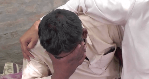 Umar Hayat grieves after the mass poisoning event that killed 31 members of his extended family.
