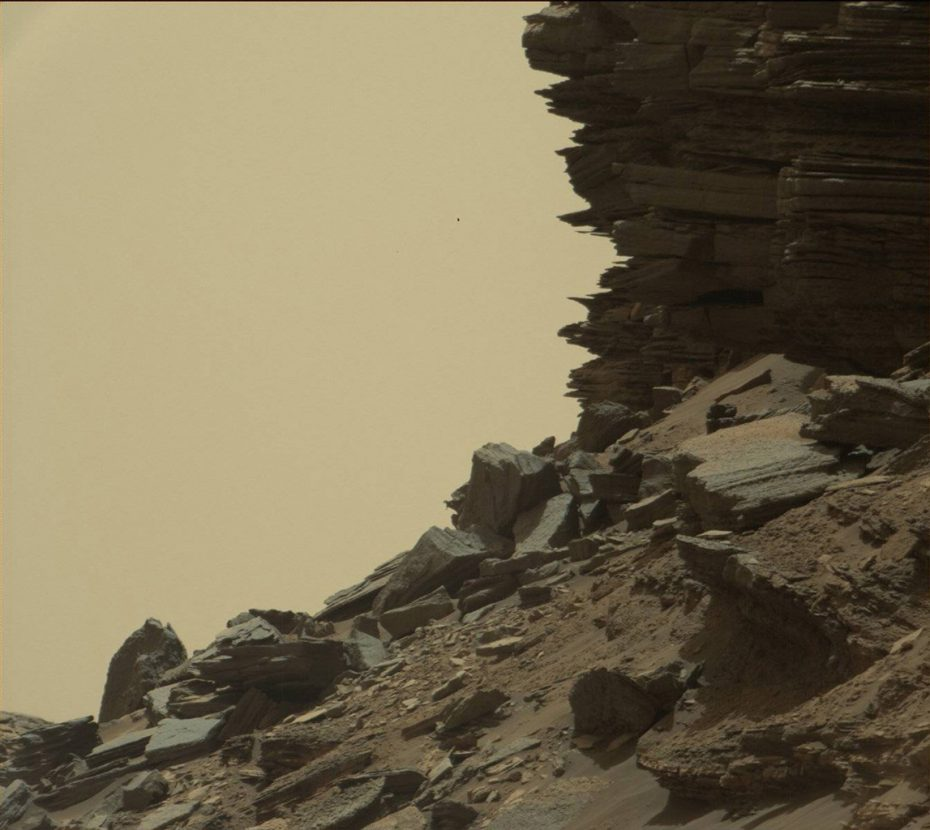 """This view from Curiosity shows a dramatic hillside outcrop with sandstone layers that scientists refer to as """"cross-bedding."""" Image Credit: NASA/JPL-Caltech/MSSS"""