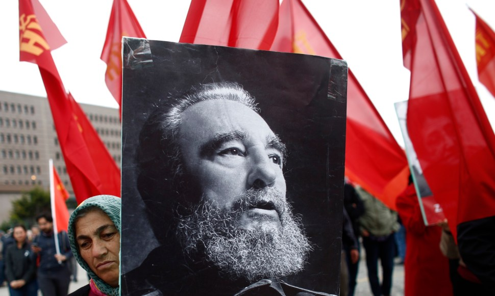 A woman carries a portrait of Cuba's former president Fidel Castro during a May Day rally in Istanbul, Turkey, May 1, 2016. REUTERS