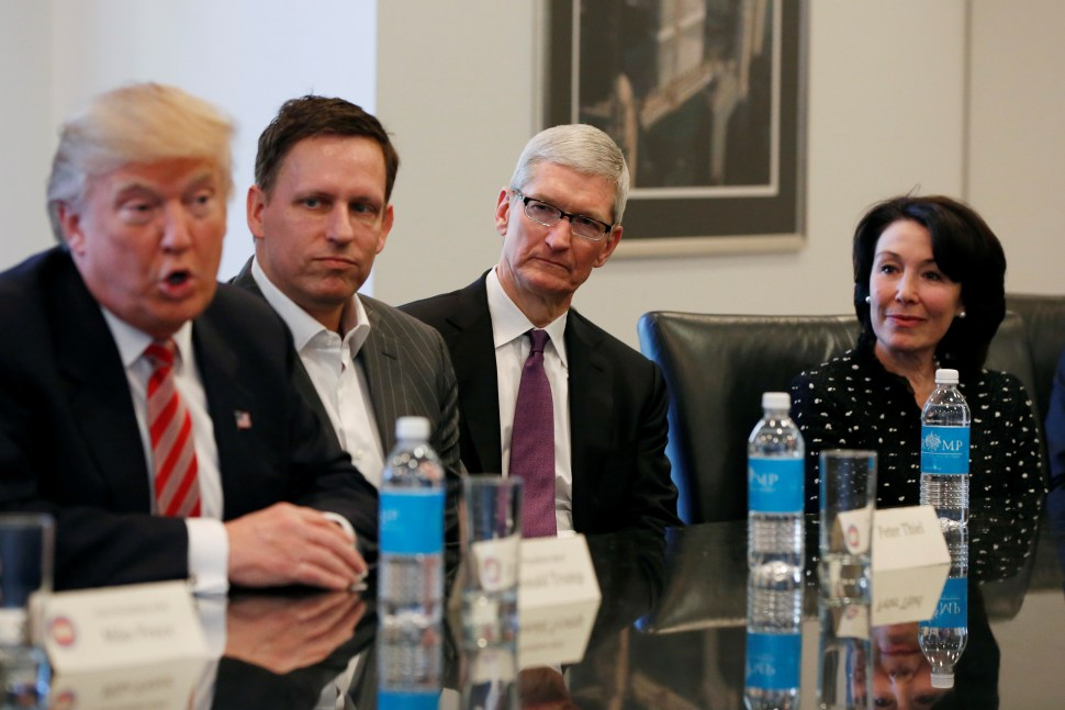 Donald Trump speaks as (2nd L to R) PayPal co-founder and Facebook board member Peter Thiel, Apple Inc CEO Tim Cook and Oracle CEO Safra Catz look on during a meeting with technology leaders at Trump Tower in New York U.S., December 14, 2016. REUTERS