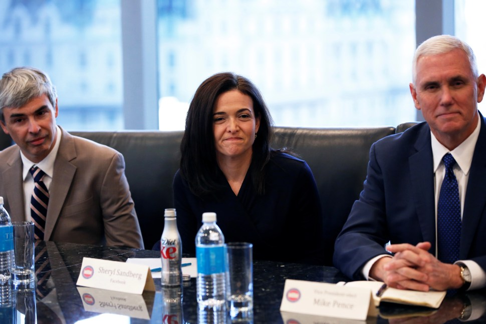 (L-R) Larry Page, CEO and Co-founder of Alphabet, Sheryl Sandberg, Chief Operating Officer of Facebook, and Vice President-elect Mike Pence sit during a meeting with U.S. President-elect Donald Trump and technology leaders at Trump Tower in New York U.S., December 14, 2016. REUTERS