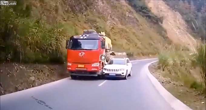 Driver exercises poor judgment by trying to pass a truck on a narrow mountain road