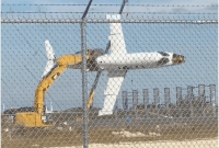 Screenshot of learjet being held by excavator, from video posted by vice.aviator on Instagram