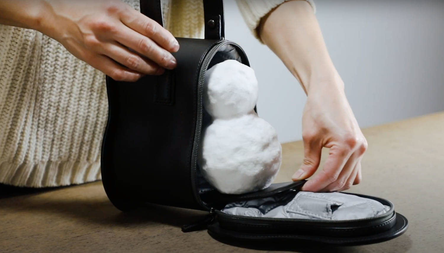 Screenshot of video of Yuko Matsuzawa crafting a carrying case for a snowman