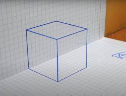 Screenshot of video on drawing a 3D cube on graph paper