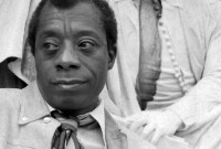 Black and white photo of James Baldwin