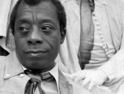 Black and white photo of James Baldwin