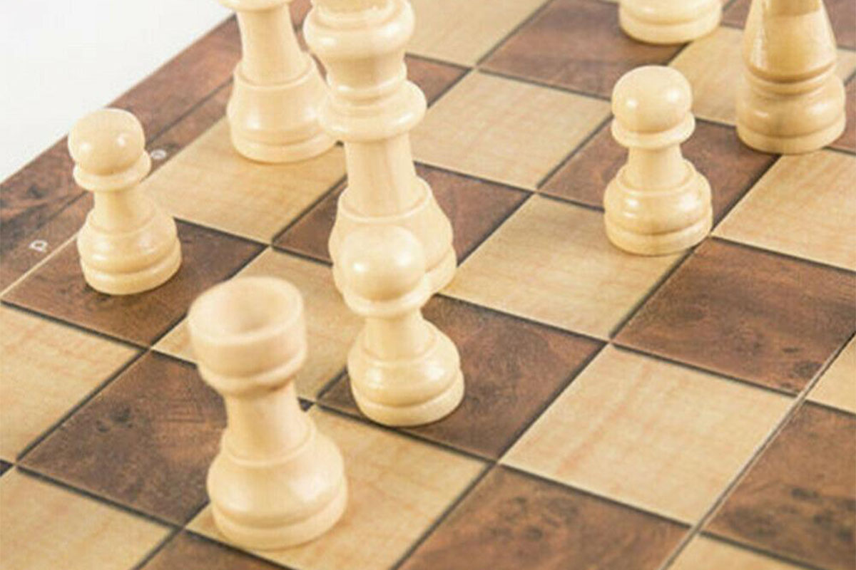 This wooden chess, checkers, and backgammon set will definitely class up your game night