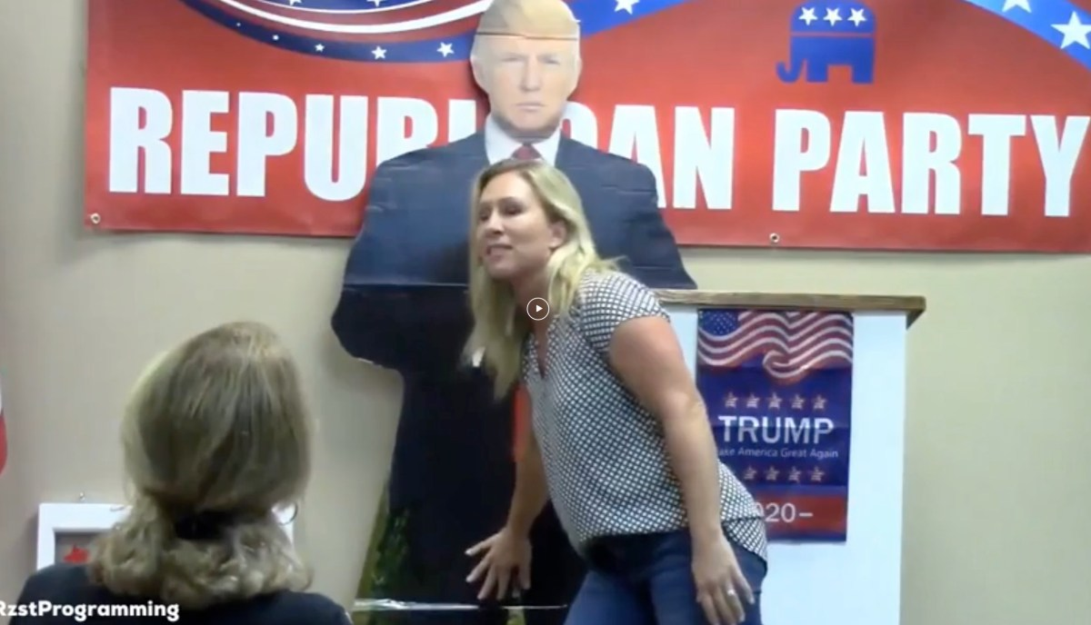 Toxic QAnon Rep Marjorie Taylor Greene rubbing her hand on crotch of a Trump cardboard cutout   Boing Boing