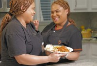 twins sisters holding bunny chow