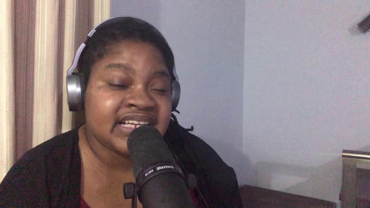 aliah sheffield sings into mic