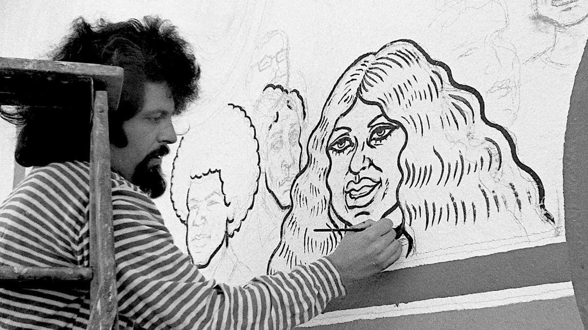 Spain Rodriguez paints a mural of a cartoon woman