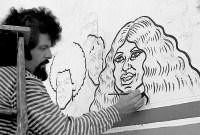 Spain Rodriguez paints a mural of a cartoon woman