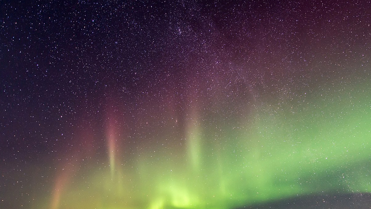 A streak of green lights in space