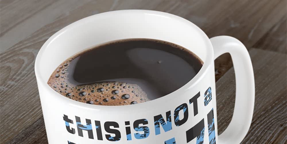 """Embrace consumerism with a """"This Is Not A Fugazi T-Shirt"""" Mug 