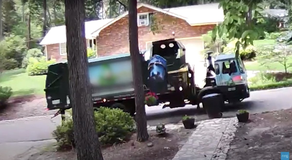 Watch: A greedy garbage truck comically swallows the trash along with the entire bin | Boing Boing