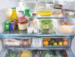 Photo of open fridge filled with food