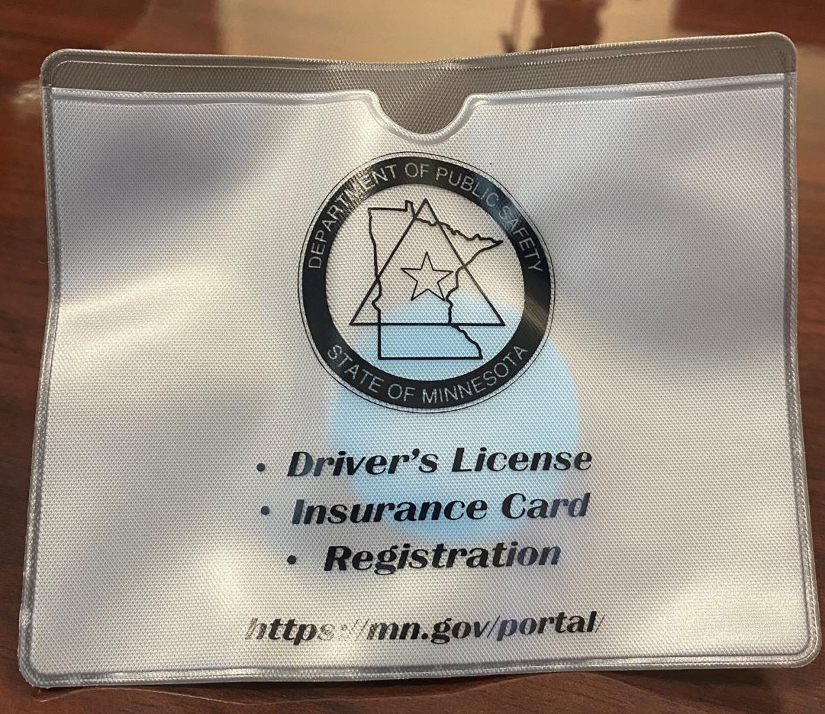 """Minnesota wants drivers to use these """"document pouches"""" to avoid getting executed by cops for reaching into the glove box   Boing Boing"""