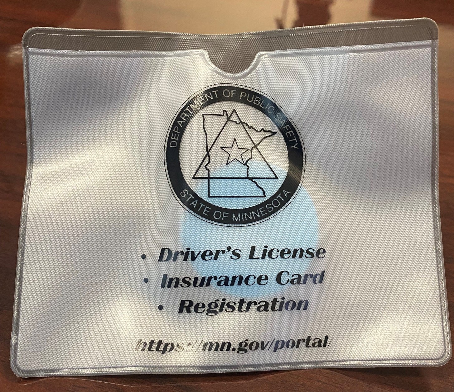 """Minnesota wants drivers to use these """"document pouches"""" to avoid getting executed by cops for..."""
