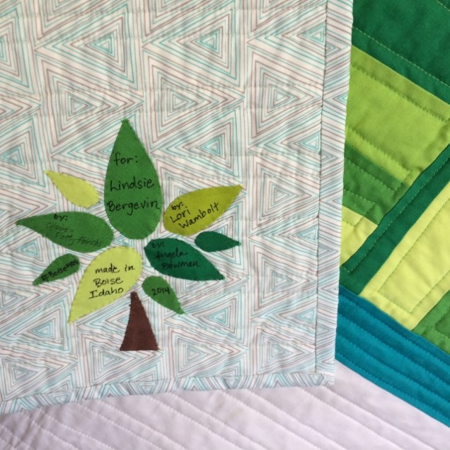 Quilt label based on a tree from the BMQG logo.