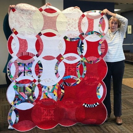 Red and White Double Wedding Ring quilt by Carol Mitchell