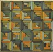 wooden art piece in quilt-like design