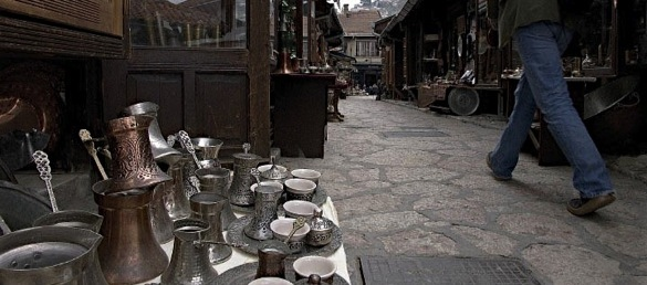 A man walks by a traditional coppersmith shop in Sarajevo's old Turkish quarter.