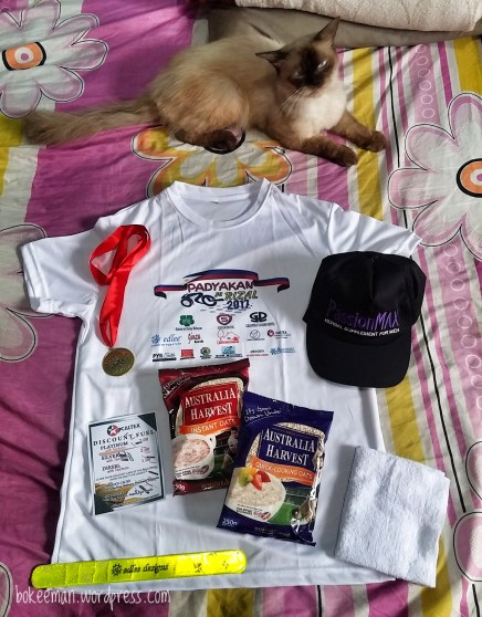 Finisher's loot bag contains medal, shirt, Australian Harvest oats, towel, safety reflectorized strip, fuel discount coupons at selected Caltex stations, and trucker cap!
