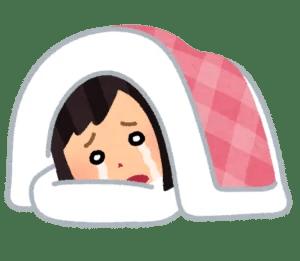 泣きながら寝る女