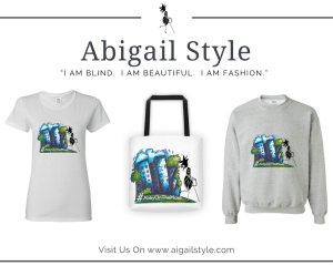 A white short sleeve tee, white tote bag with black handles and a grey sweatshirt all decorated with a whimsical image of a blue cityscape with Abigail walking past and the hashtag #AbbyOnTheMove on the bottom. www.abigailstyle.com