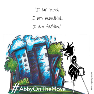 A whimsical image of a blue cityscape with Abigail walking past and the hashtag #AbbyOnTheMove on the bottom. www.abigailstyle.com