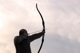 Archer aiming his bow and arrow