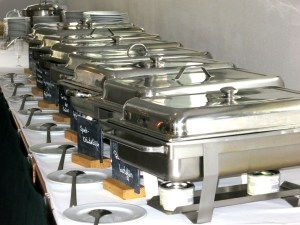 Chafing dishes lined up on a buffet table