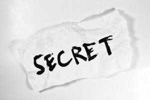 "The word ""secret"" on a piece of paper"