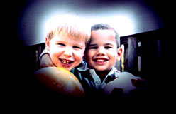 A view of what of how two little boys holding a ball appear through the eyes of a person with glaucoma.