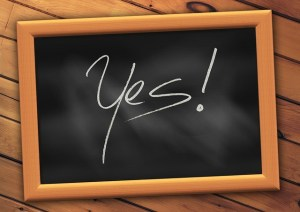 """Wooden framed slate board with the word """"Yes!"""""""