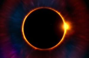 """Baily's Beads, On the right side of the moon, orbs of glowing sunlight shimmer off the edge of the moon's black disk. Called Baily's Beads, these final areas of the sun's light appear as glimmering pearls on a wire, made intensely bright by the absence of light surrounding them."" ~Eclipse Soundscapes"