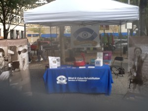 Blind & Vision Rehabilitation Services of Pittsburgh table, banners and awareness materials.