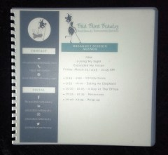 Photo of the braille bound agenda, information on Bold Blind Beauty, and resources. The cover is a translucent textured plastic. Braille copies were provided by Miamia Accessible Media Project.