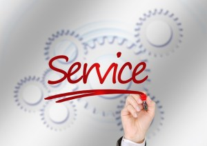 "Eight connected gears are in the background of the word ""Service"" in red letters."