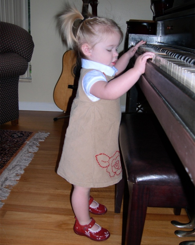 3. Standing at Piano image description is in the body of the post.